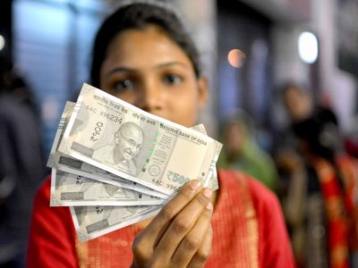 Rupee falls on report a minister urges devaluation; Finance Ministry denies